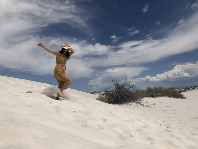 sabrina running down hill in white sands new mexico